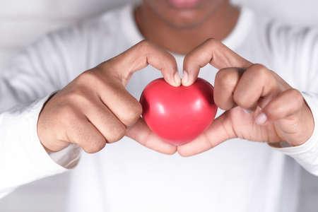 Photo pour hand holding red heart symbol on white background . - image libre de droit