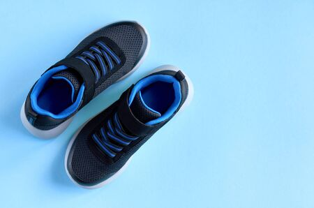 Photo pour Sneakers on blue background composition, shoes for run. Flat lay and top view photo - image libre de droit