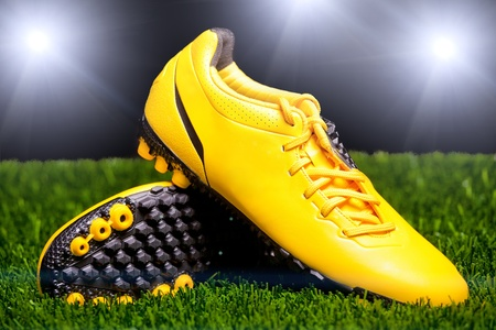 Football boots on the grass