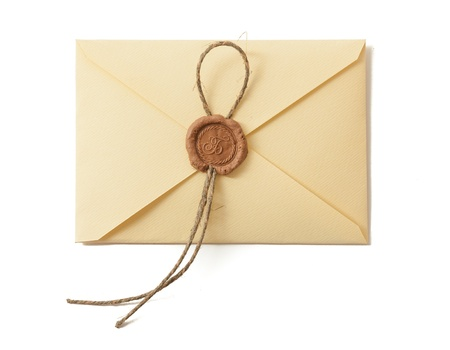 Envelope with seal isolated on white. Closeup.