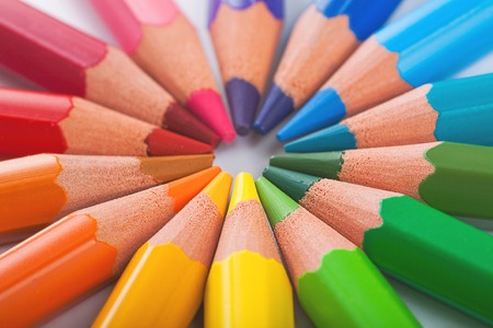 Photo for Color pencils in arrange in color wheel colors on white background - Royalty Free Image