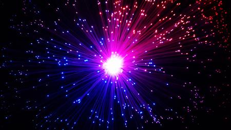 Photo pour Multicolored optical fiber cables with shining tips on a black background - image libre de droit