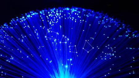 Photo pour Blue optical fiber cables with shining tips on a black background - image libre de droit