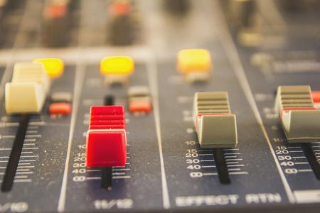 Photo pour Slide the button to adjust the volume mixer of audio professionals. In the studio recording. - image libre de droit