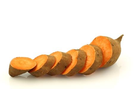 a cut sweet potato on a white background