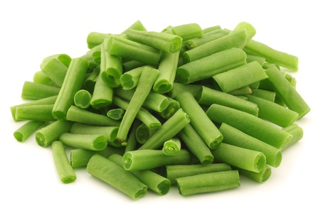 cut small and slender green beans  haricot vert  on a white background