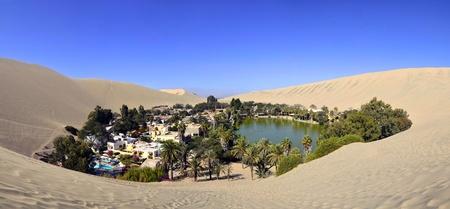 Stitched Panorama of Beautiful Huacachina Oasis surrounded by sand dunes near Ica Peru