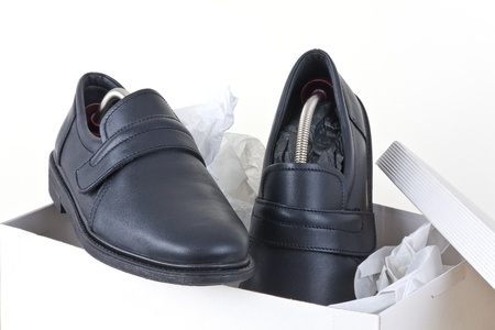Shoes for men packed into a shoebox.