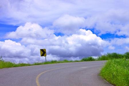 Sharp curve and cloud sky