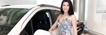 Photo pour Charming customer brunet buying a new car in dealeship center - image libre de droit