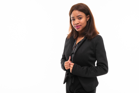 Photo pour emotional african-american young girl in black suit possing isolated on mockup background - image libre de droit