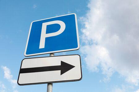 Photo pour Closeup of Roadsign Parking lot on right against sky - image libre de droit