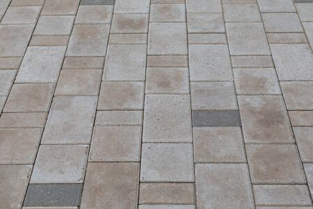 Photo for Close-up of grey and beige paving tile outdoors on ground - Royalty Free Image