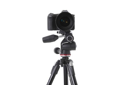 Photo pour Front view of modern multifunctional black camera on holder isolated. Photo with depth of field - image libre de droit