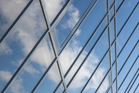 Photo pour Diagonal view of glass building view with sky reflection, business office facade. - image libre de droit