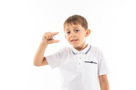 Photo for A little blonde boy shows a little, picture isolated on white background. - Royalty Free Image