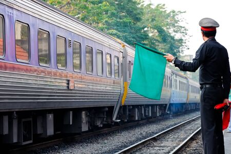 Green flag signal from station master,Thailand