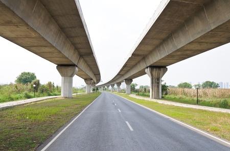 Empty asphalt road under the new expressway line.