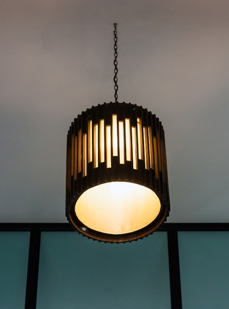 Modern lantern is hanging in the lobby of hotel.