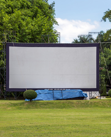Large movie screen in the meadow of Thai village.