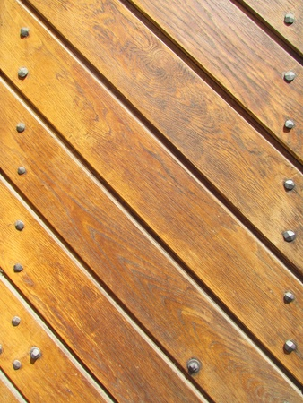 Wood slat background with metal studs
