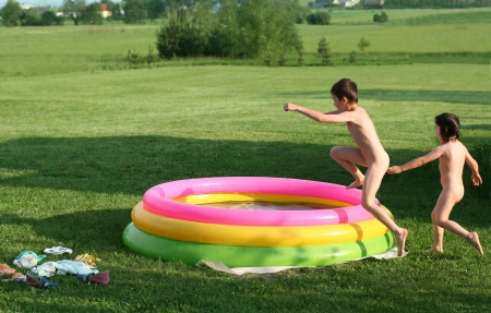 crazy children, summerfun sibling in pool, jumping to water