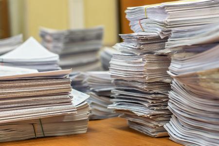 Photo pour bundles bales of paper documents. stacks packs pile on the desk in the office - image libre de droit