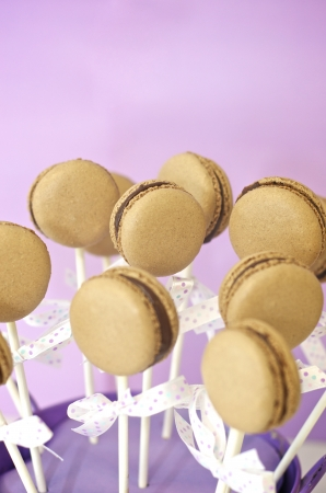 Chocolate macaron pops in a small bucket