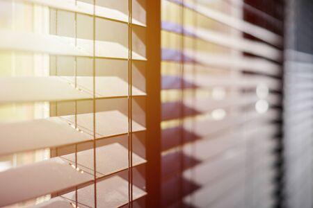 Photo pour Office blinds. Modern wooden jalousie. Office meeting room lighting range control. - image libre de droit