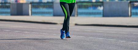 Foto de Running woman. Fitness woman jogging in sportswear on city road. Healthy lifestyle, sport hobby. Street workout, sprinting outdoor - Imagen libre de derechos