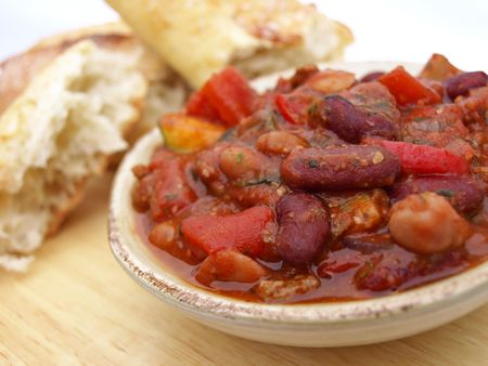 Serving of chili with beans, tomatoes and bread