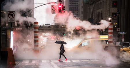 Photo pour A woman wearing red high heels is crossing the 42nd street in Manhattan during the Covid-19 outbreak. Manhattan, New York City, United States. - image libre de droit