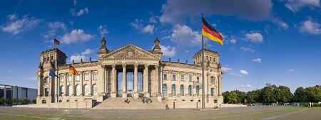 Blue sky and German flags flying over the Reichstag, Berlin