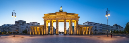 Pretty night time illuminations of the Brandenburg Gate (1788) inspired by Greek architecture, built as a symbol of peace and nationalism, now an emblem of reunification.
