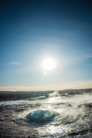 Iceland Strokkur geyser before eruption water bubble fountain hot steam
