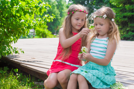 Portrait of adorable little girls on a warm summer day