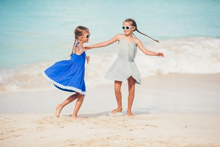 Photo pour Happy kids running and jumping at beach - image libre de droit