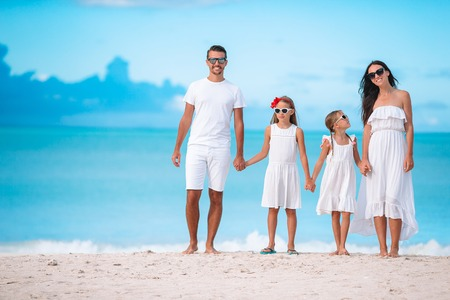 Photo for Happy beautiful family with kids on the beach - Royalty Free Image