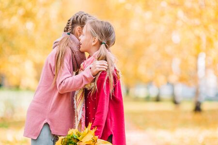 Photo for Little adorable girls outdoors at warm sunny autumn day - Royalty Free Image
