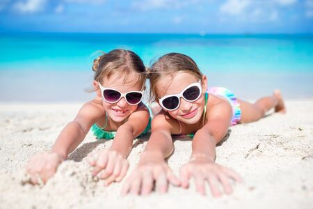 Photo for Portrait of two beautiful kids looking at camera background of beautiful nature of blue sky and turquoise sea - Royalty Free Image