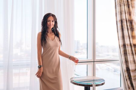 Photo pour Beautiful young girl in a long dress in hotel on the party - image libre de droit
