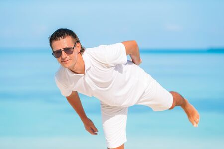 Photo for Young man on the beach having fun - Royalty Free Image