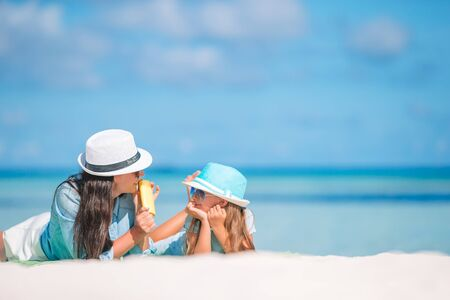 Photo for Mother applying sun cream to daughter hand. Sun protection - Royalty Free Image