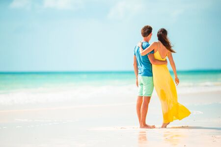 Photo for Young couple on white beach during summer vacation. - Royalty Free Image