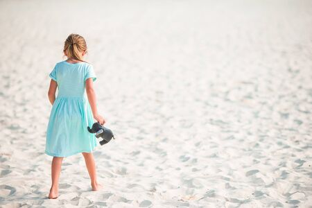 Photo for Adorable little girl at tropical beach on vacation - Royalty Free Image