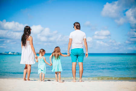 Photo for Young family on summer beach vacation - Royalty Free Image