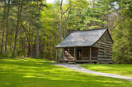 A rustic log cabin sits in Cades CoveSmokey Mountain N.P. in eastern Tennessee.