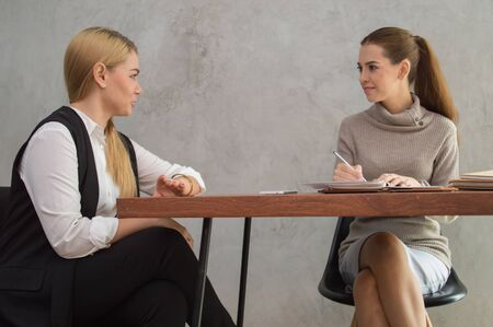 Business Concepts, Young business woman is meeting in office. Young businesswoman is working happily. Businesswomen work as a team for success. Business people work with smiles.