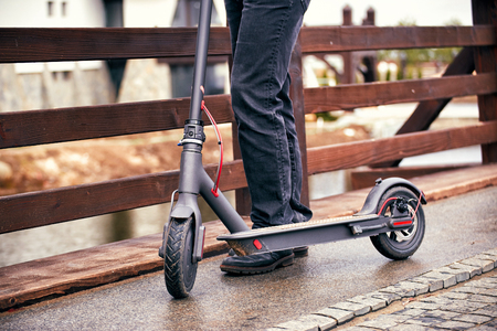Photo for Use of scooter as a means of transportation on the street. - Royalty Free Image