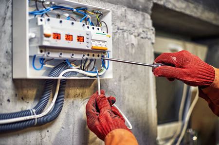 Photo pour Maintenance of the electrical system. Work tests of the electrical circuit. - image libre de droit